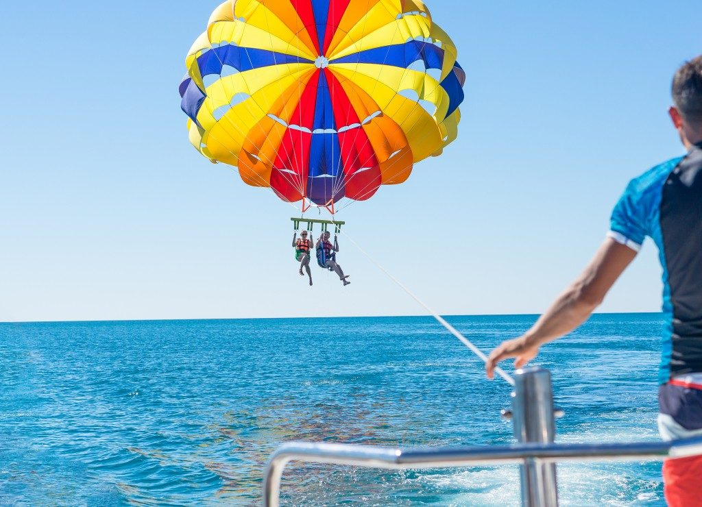 Couple parasailing in summer