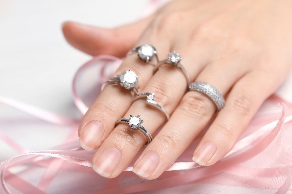 engagement rings on woman's hand