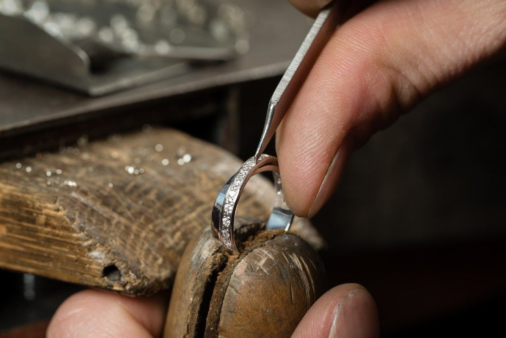 Jeweler making a wedding ring