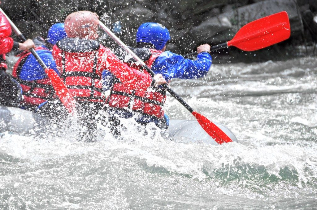 group of people doing white water rafting