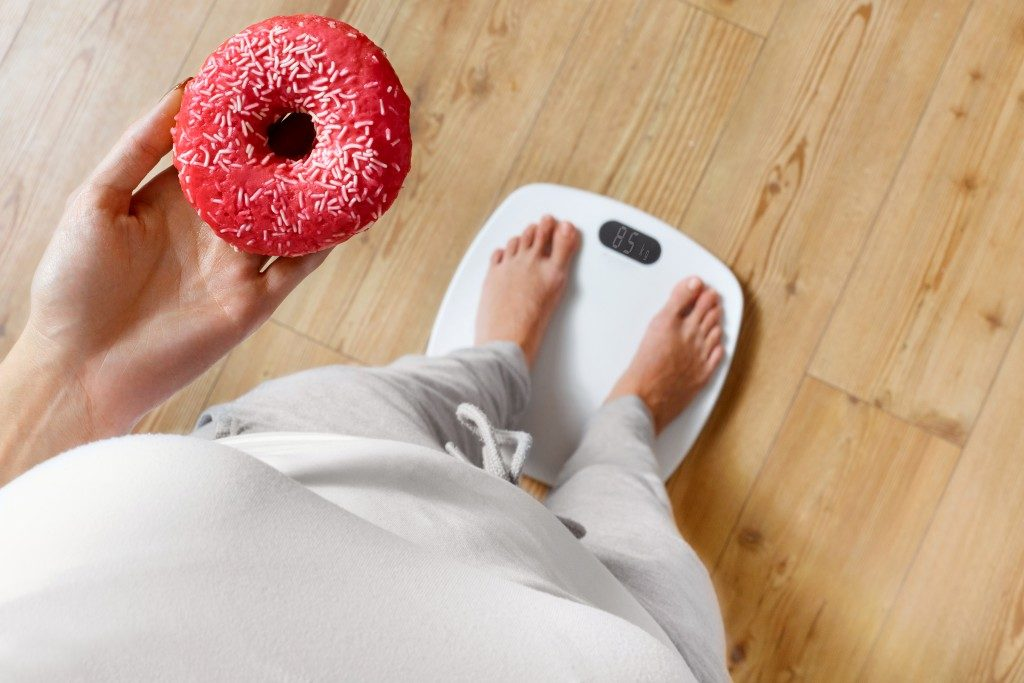 On weighing scale holding donut