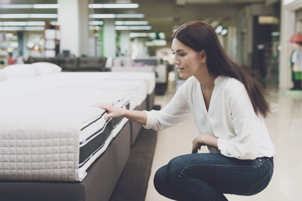 woman picking out a mattress