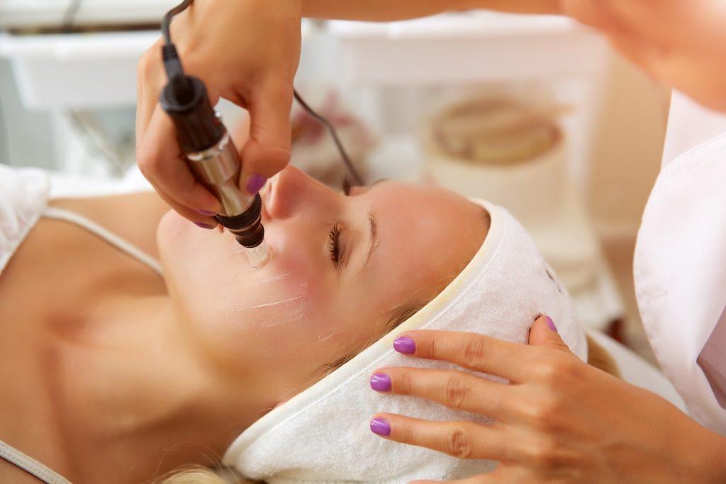 woman having a facial spa