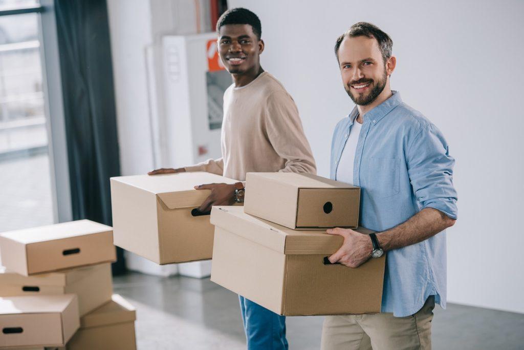 Men holding box