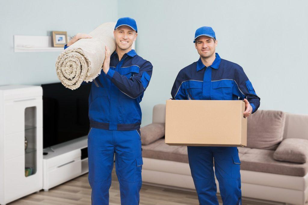 Guys holding box and carpet