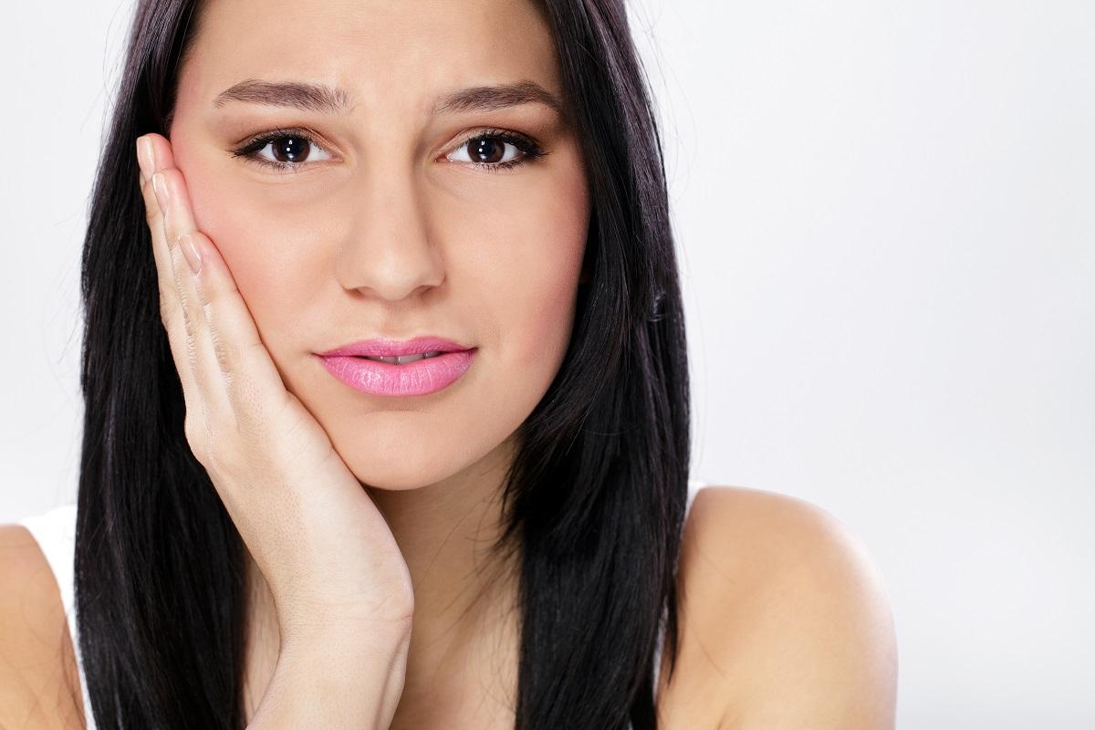 woman touching her chin