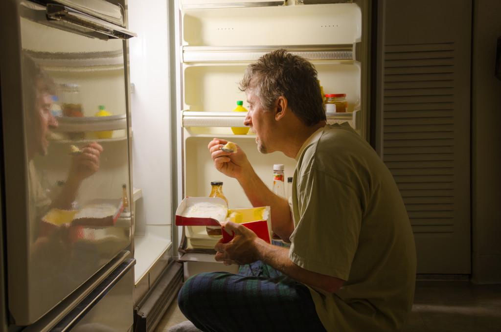 man binge eating