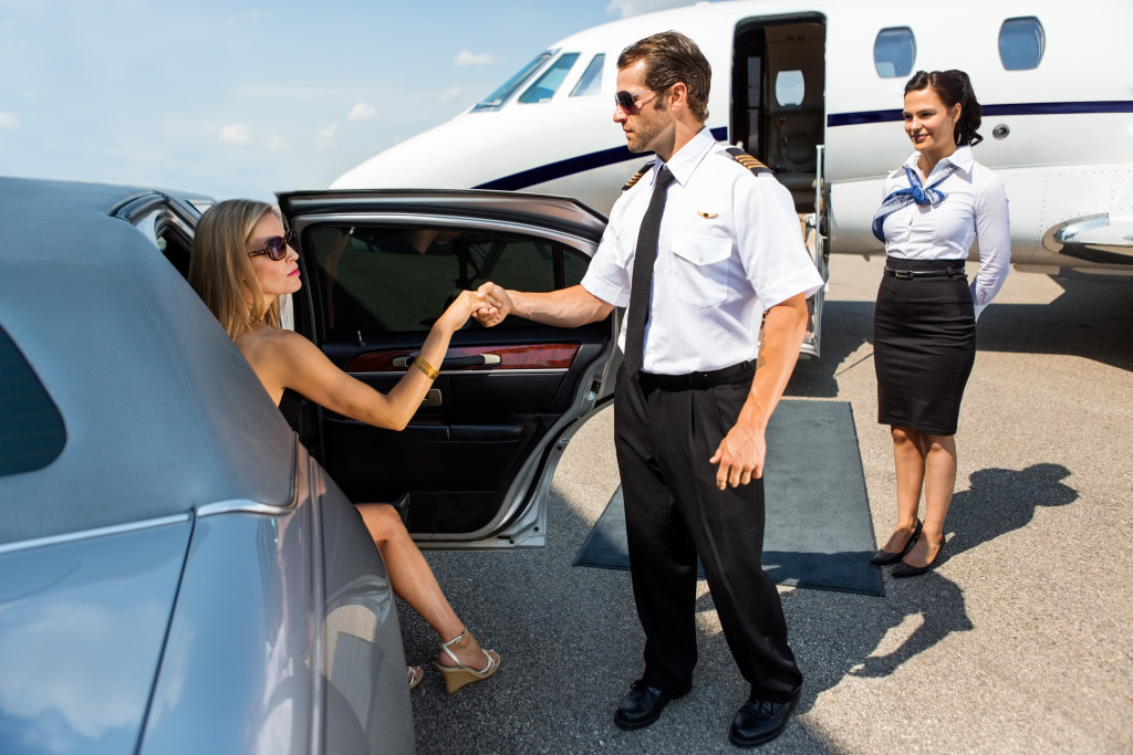 woman boarding a private jet